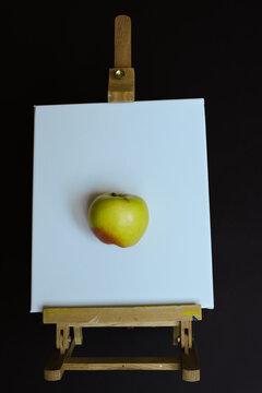 Three-dimensional apple on canvas