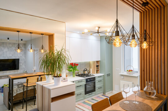 Modern classic white kitchen interior with dining zone
