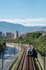 Fototapeta Medellin, Antioquia, Colombia. July 2020: Metro of the city and bridge 4 sur with blue sky.