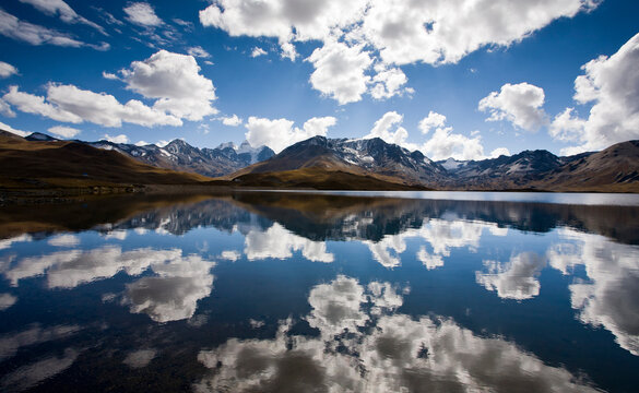 Reflections of Mt. Tuni Condoriri in the Tuni Reservoir below the Cordillera Real, Bolivia in winter.