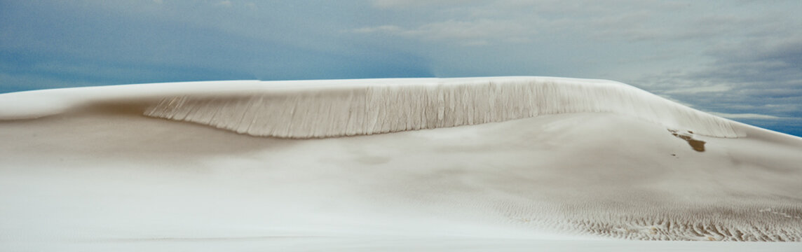 Great Sand Dunes, CO: A steep ridge creates a sand avalanche which is only enhanced by the recent snowfall