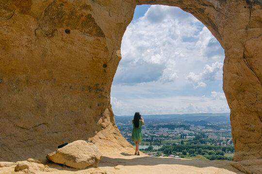 A tourist (girl) standing inside of Ring mount (Gora Kolzo). Kislovodsk, Stavropol Krai, North Caucasus, Russia.