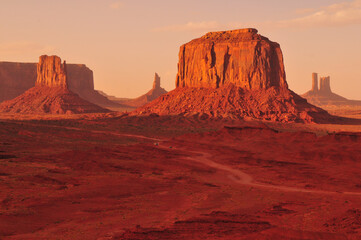 Late afternoon light bathing the buttes and mesas of Monument Valley, Utah - Arizona border