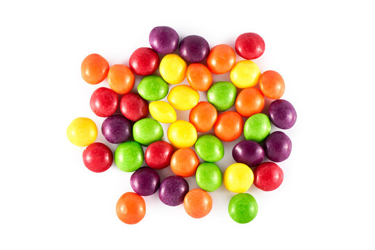 Heap of colored round dragee sweets isolated on white background, top view, flat lay. Multicolored.candy