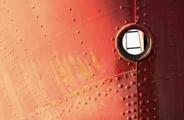 Forebody of an old orange grunge ship in Basel Switzerland, Holzpark Klybeck.