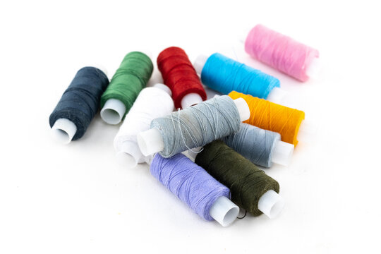 thread material for embroidery and sewing holes on clothes green, lilac and red on a white background