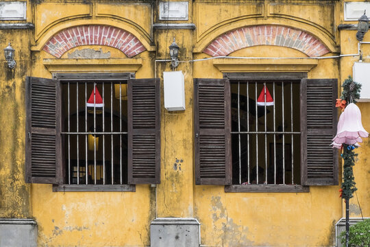 Vietnamese windows with bars and shutters