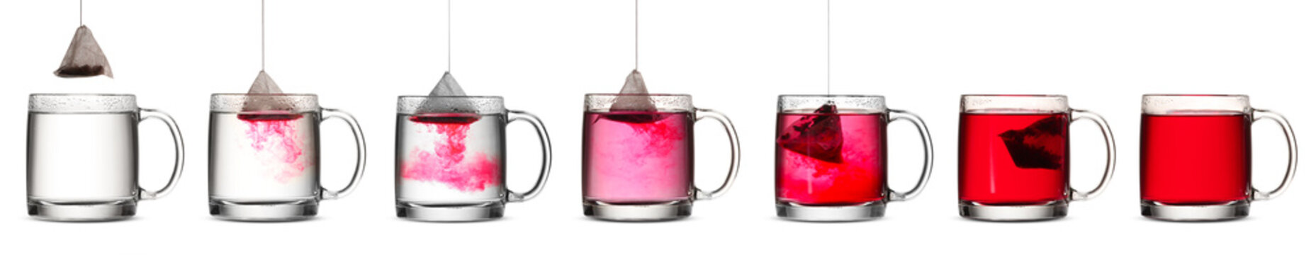 Process of making tea in glass cup on white background