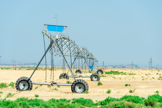 Irrigate Sprayer working in a field of Farm