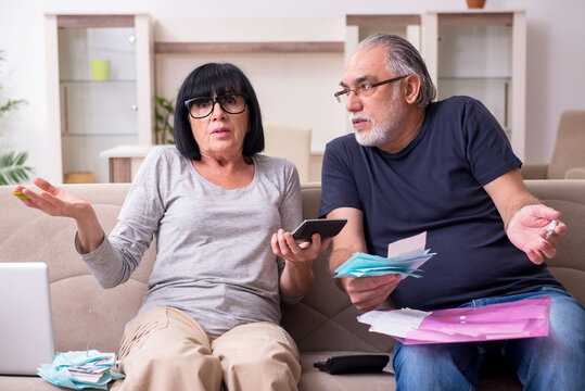 Old couple discussing family finances