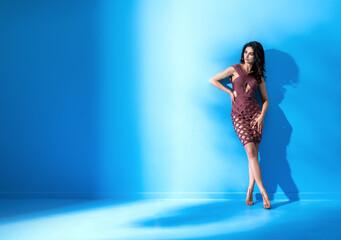 Fit, flexible dancer wearing a trendy, elegant dress