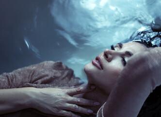 Beautiful brunette woman relaxing in the bathtube