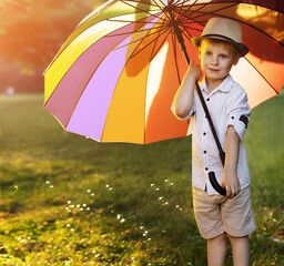 Cute, little boy holding a colorful umbrella