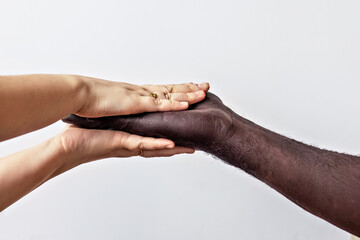 Black male and white female hands, open palms to each other. A symbol of the struggle for black rights in America. The concept of equality and the fight against racism Wall mural