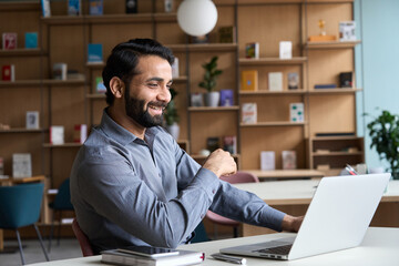 Happy indian professional young adult man having video conference call virtual business meeting...