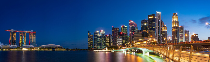 Ultra wide panorama of City scape of Singapore central area at magic hour.
