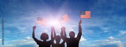 USA flag on sky background. American holidays