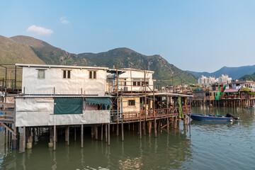 Fototapete - Residential stilt house with tin siding in Tai O fishing village, Lantau island, Hong Kong