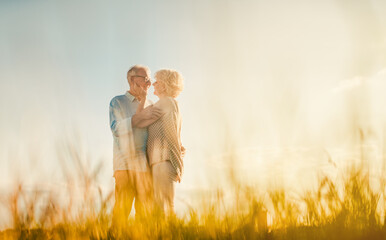 Senior couple embracing each other in love outdoors