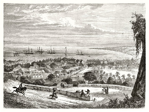Large view from top of Saint-Paul, Reunion island, gulf, sea, and ships far in the distance. Ancient grey tone etching style art by De Berard, Le Tour du Monde, 1862