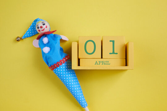 April Fool's Day background. Numbers cube with clown on yellow background