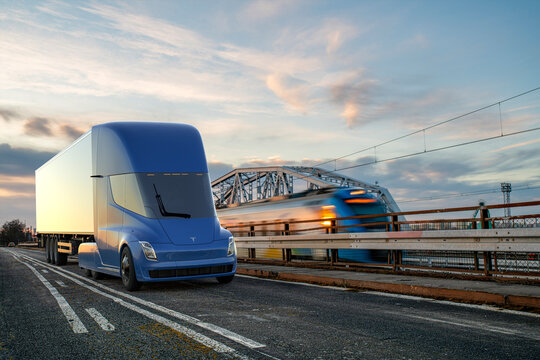 Tesla's electric truck running parallel to the electric train