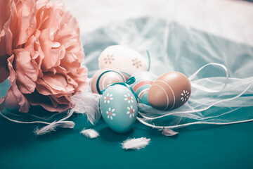Colorful easter eggs in pastel colors with copy space.