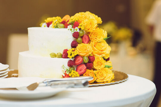 wedding cake with fruits and flowers