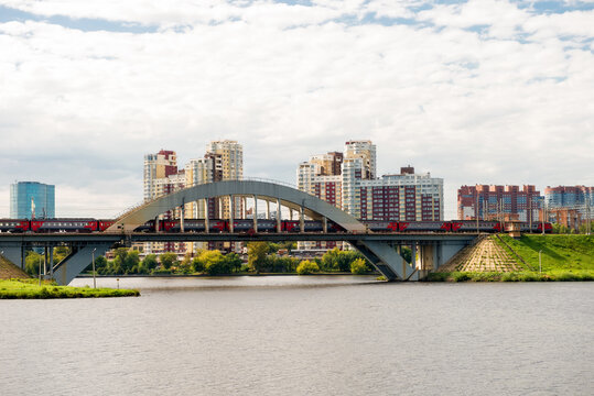 View of residential buildings in the city of Khimki and the railway bridge across the Moscow canal
