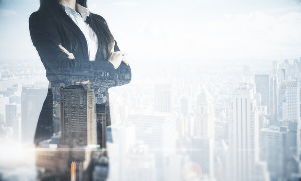 Business success concept with businesswoman and smoky city skyscrapers background. Double exposure