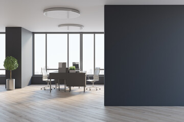 Fototapeta Blank black wall in spacious office hall with city view from big window, wooden tables and floor, tree in a metallic flowerpot and stylish lamps on top. 3D rendering, mock up obraz