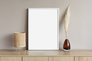 Fototapeta Blank picture frame mockup on gray wall. White living room design. View of modern scandinavian style interior with artwork mock up on wall. Home staging and minimalism concept