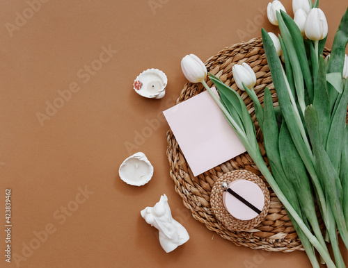 Greetings card, Spring composition. White tulips and candle on brown background. Mother day, 8 march. Blank greeting card. Flat Lay, Still life composition
