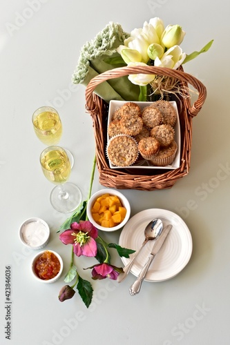 Simple breakfast brunch pastry muffins and champagne for  Mother's Day morning in bed or romantic holiday weekend. Photo concept food background, close-up, copy space