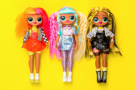 Moscow, Russia - March, 2021: LOL OMG dolls on yellow background. Collection of dolls lol. Popular dolls for girls
