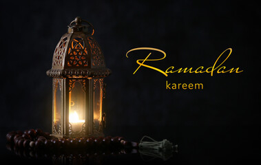 Wall Murals Graffiti Muslim lamp and tasbih on dark background. Celebration of Ramadan