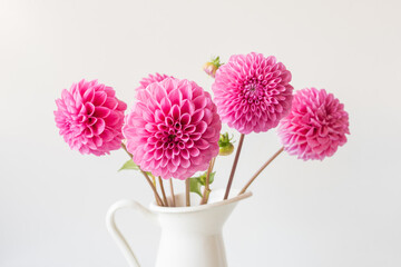 Printed kitchen splashbacks Dahlia Closeup of bright pink dahlia blossom amongst bunch in white jug (selective focus)