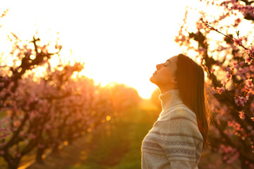 Woman breathing at sunrise in a field