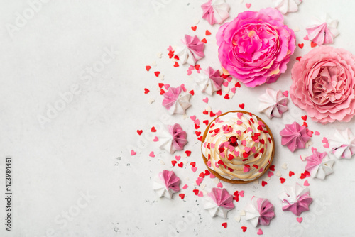 Mother's day holiday brunch with cupcake craem and pink flowers on white background