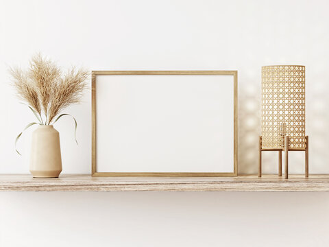 Small horizontal wooden frame mockup in japandi style room interior with caned lamp and dried Pampas grass on empty white wall background. A4, A3 format. 3d rendering, illustration