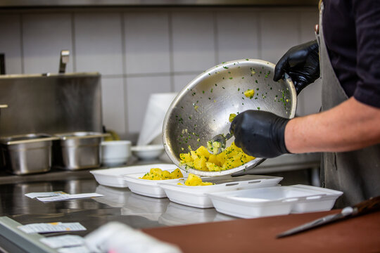 Chef preparing takeaway dish in the restaurant or pub , food delivery concept, home delivery, online order