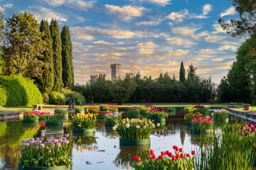 Picturesque image of the Scaligero castle of Valeggio sul Mincio. Veneto Region, province of Verona. Castle seen from the Segurt park, a flowery park dedicated to nature