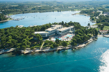 The hotel is located in a natural park on a small island in a sea lagoon. Shooting from a drone.