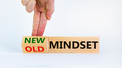 New vs old mindset symbol. Businessman turns the wooden block and changes words 'old mindset' to 'new mindset'. Beautiful white background. Business, new or old mindset concept. Copy space.