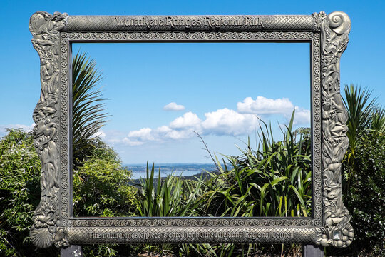 Vista viewed through large fixed frame of forest park in New Zealand