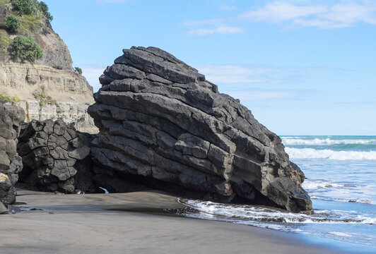 Part of a lava flow from an ancient volcano, a pillow lava collapsed on the seashore