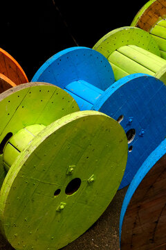 A Store of cable drums painted different colours
