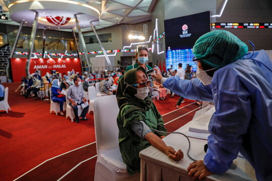 COVID-19 mass vaccination programme at the Indonesia Stock Exchange in Jakarta