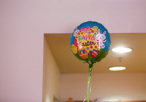 An Easter balloon floats in the room of Uomoto at Nikkei Manor, an assisted living facility in Seattle