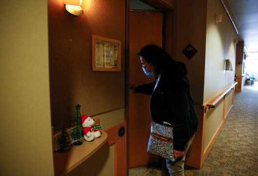 Sakaguchi enters the room of her mother Sakaguchi, 94, at Nikkei Manor, an assisted living facility in Seattle